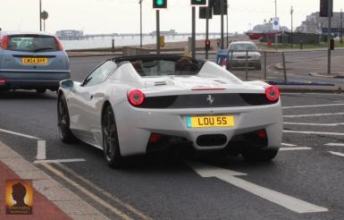 Ferrari on a beach drive-by