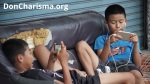 boys playing games smartphone sofa