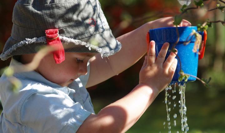 child water playing