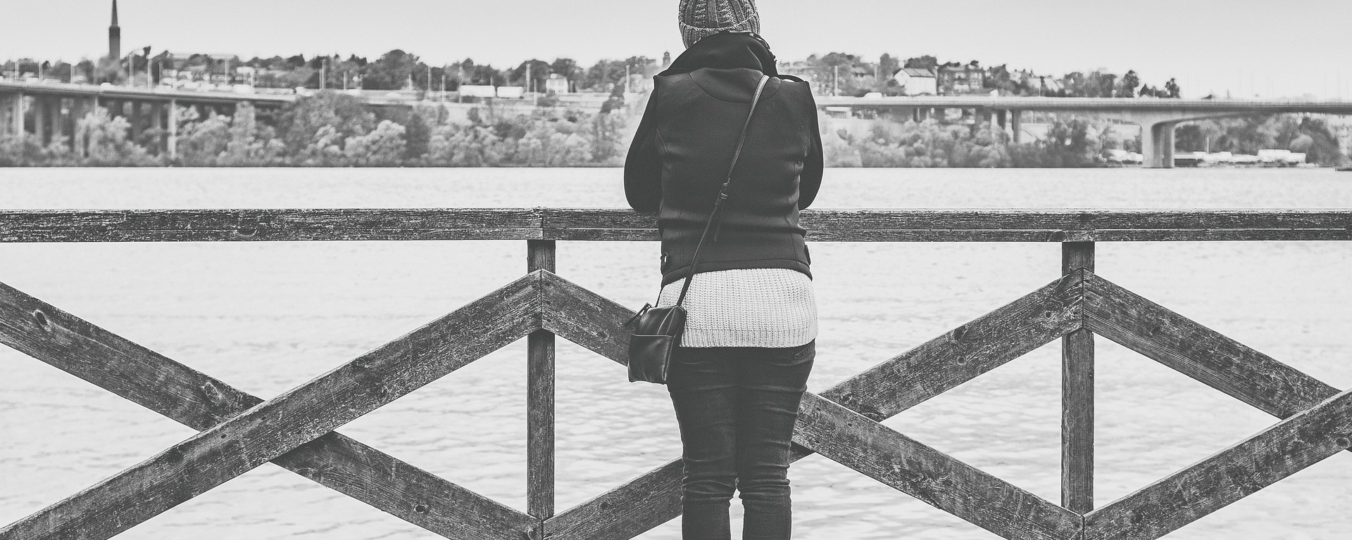 woman,view,stockholm,sweden,looking,out,thinking,wondering,future,past,problem,solution,planning,imaging,considering,girl,female,person,watching,clouds,water,sea,city,cityscape,hat,wood,fence,protection,outdoors,construction,depression,anxiety
