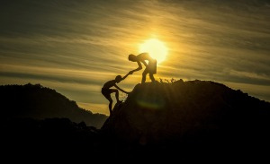 adventure,height,climbing,mountain,peak,summit,help,teamwork,support,assistance,boys,challenge,cliff,climb,companion,exercise,extreme,friend,friendship,hands,hiker,men,nature,outdoor,partner,rescue,silhouette,strong,success,sunrise,sunset,young