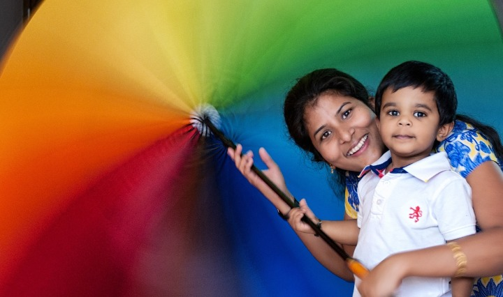 rainbow,umbrella,colorful,happy,mother,son,green,yellow,red,orange,smiling,smile,face,young,hair,woman,healthy,enjoyment,DON CHARISMA
