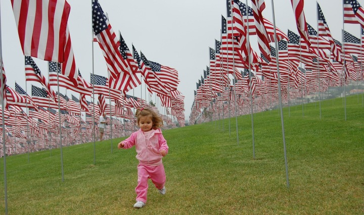 toddler,patriot,patriotic,girl,running,flags,usa,america,stars and stripes,lawn,grass,freedom,young,child,kid,happy,cute,childhood,outdoor,green,park,memorial day,veterans day,july 4th,princess,pink,DONCHARISMA