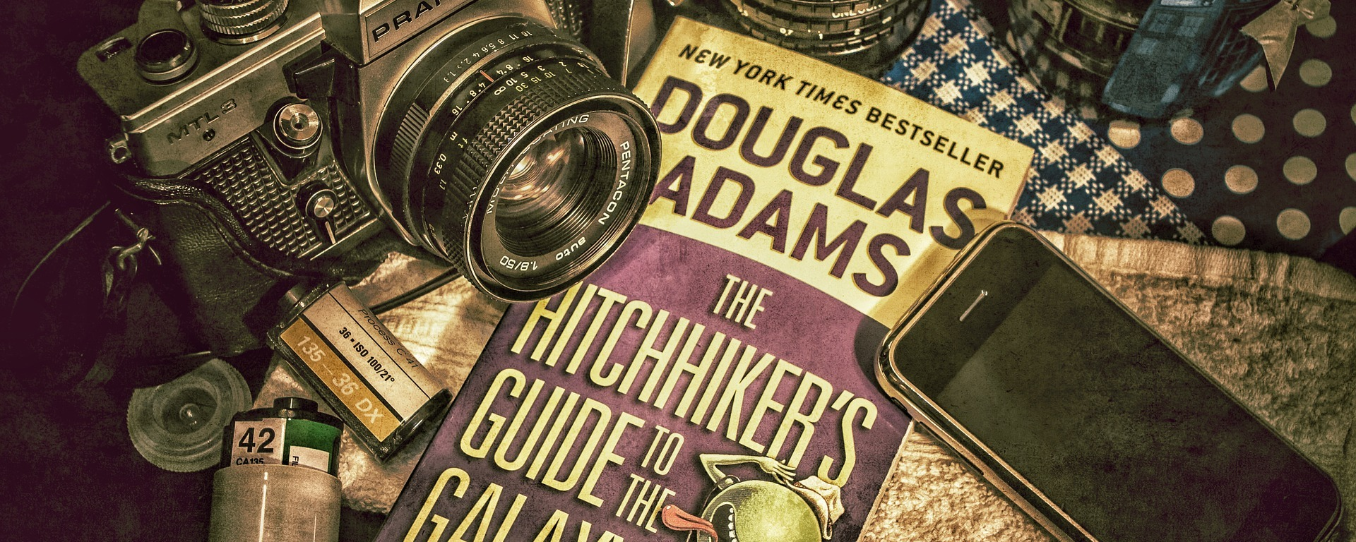 douglas adams,hitchhikers,guide,galaxy,analog,film,photography,iphone,vintage,fisheye,towel,book,tea,cup,relaxation,hot,table,prepared,morning,DON CHARISMA