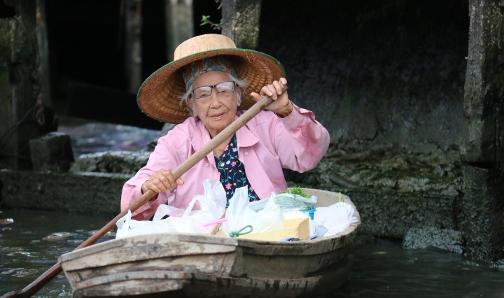elderly woman,boat,vessel,courage,strength,age,paddling,channel,transport,pink,hat,old,river,cannal,hard life, DON CHARISMA